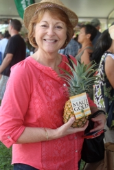 Senator Roz Baker displays Maui's favorite fruit.
