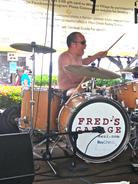 Ray Chin of Fred's Garage Band shows his joy drumming shirtless (it was a hot day)