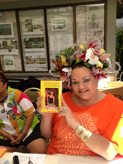 "The popular ""Morning Goddess"" of KPOA radio displays the author's third book."