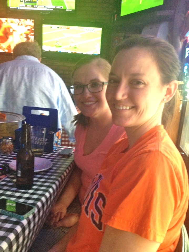Two Illini fans and graduates, one visiting from Washington D.C, and the other from Chicago enjoy the game.