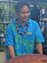 Worker removes table from open area at Kaanapali Beach Hotel