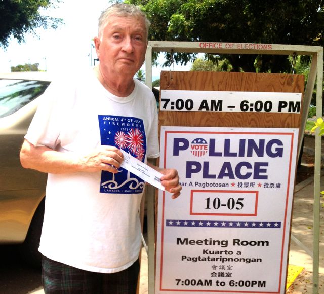 Blogger, reporter, photographer after voting at Lahaina Civic Center today.