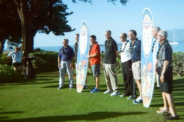 Surfboards with school logos displayed by coaches.