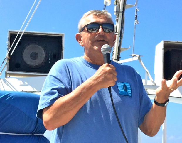 Flip NIcklin giving a talk on a whale watch cruise
