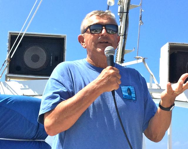 Flip NIcklin giving a talk on a whale watch cruise