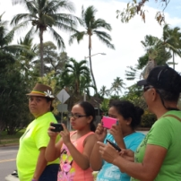 Waiting for marchers to cross Honopiilani Highway to enter Moku'ula, former home of Hawaiian royalty