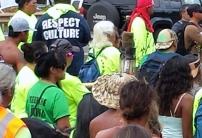 Hawaiians move forward on the march headed by torch holders and led by Kupuna Keomoku Kapu.