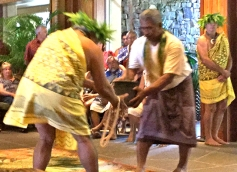 A Hawaiian offers a gift