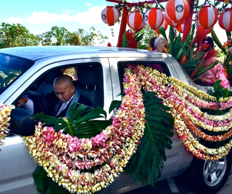 Laden with leis