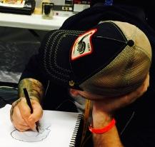 An artist works on a design.