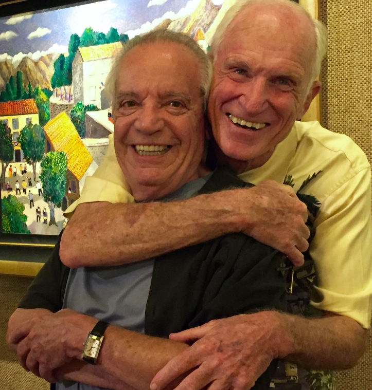 Jim Killett whose Lahaina Galleries has graced Front St for forty years hugs iconic artist Guy Buffett during one of his last appearances. Killett did a lot for Buffet and Buffet a lot in making the gallery a success. An article is in development.